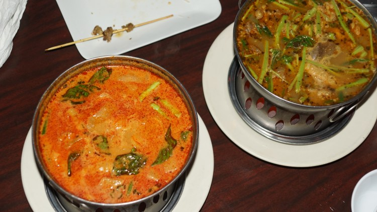 "On the left, Khmer curry. On the right, the crowd favorite, Ma Joo Krueng or ""sour "" ""lemongrass paste "" curry soup with beef."