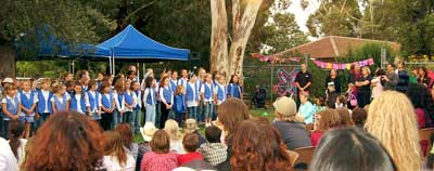 The school choir leads the celebration of a great 25 garden years.
