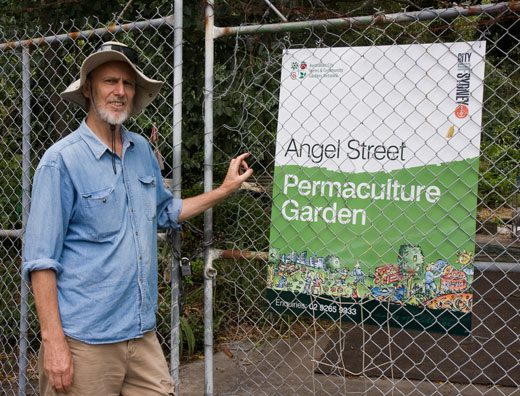 Alan Shephard with Angel Street Permaculture Garden's new sign. Note the logo for the Australian City Farms & Community Gardens Network in the sign's upper left corner — thanks City of Sydney.