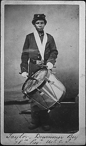 Black and white photo of a Black drummer boy from the 78th regiment of the US Colored Troops.
