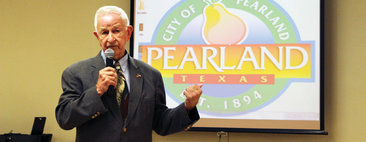 Pearland Mayor Tom Reid addresses friends and family at his birthday celebration in September.