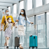 Family traveling following COVID-19 travel guidelines