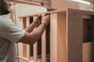 person working on woodcraft