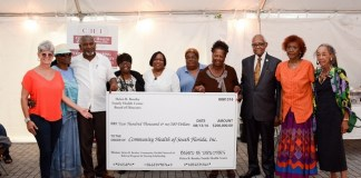 CHI receives $200,000 check during partnership celebration