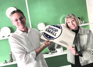 David and Marianne Russell strike a pose with a Small Business Saturday tote bag at Arango Design Store of South Miami.