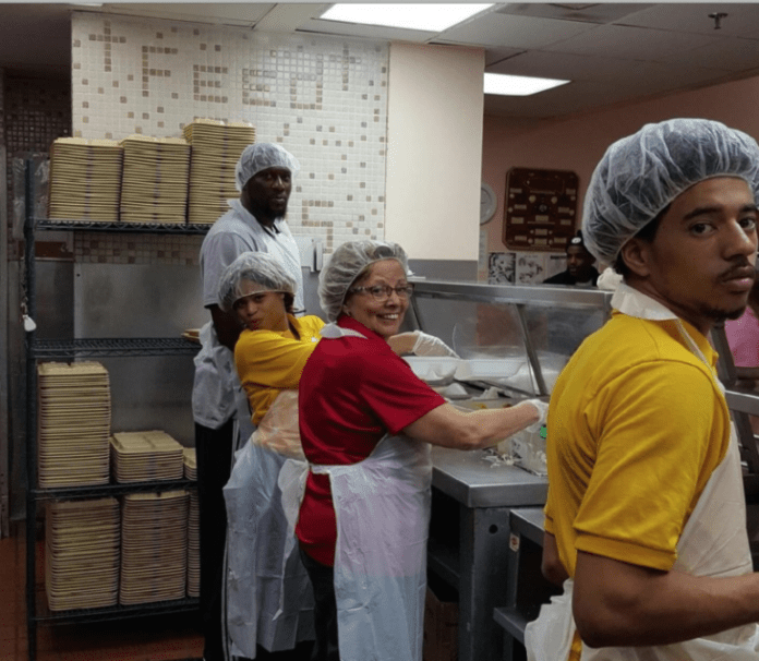 L to R: Miami Job Corps Center's Security Officer Errol Roberts, student Malaysia Harris, Center Director Mary Geoghegan and student Anthony Howell volunteered on MLK Day at Miami Rescue Mission.