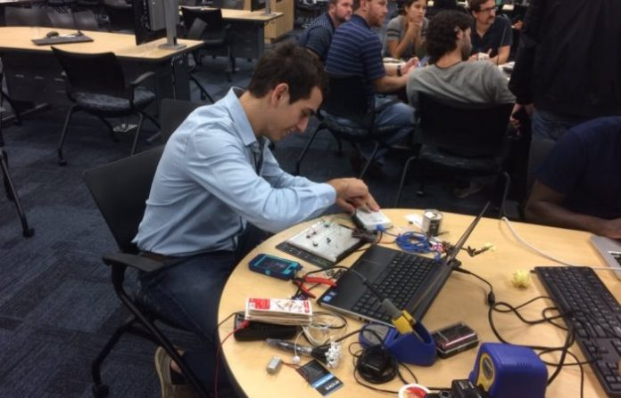 Photograph of Engineer at FIU's Hackathon