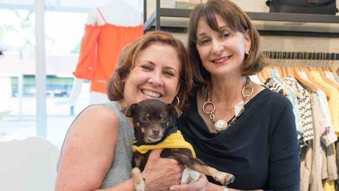 Hostess Lucille Zanghi for the Born Free Pet Shelter's event at the Trina Turk and Mr. Turk MiMo Boutique. Seen here with dedicated shelter supporter Maria Delange and an adorable adoptable Chihuahua.