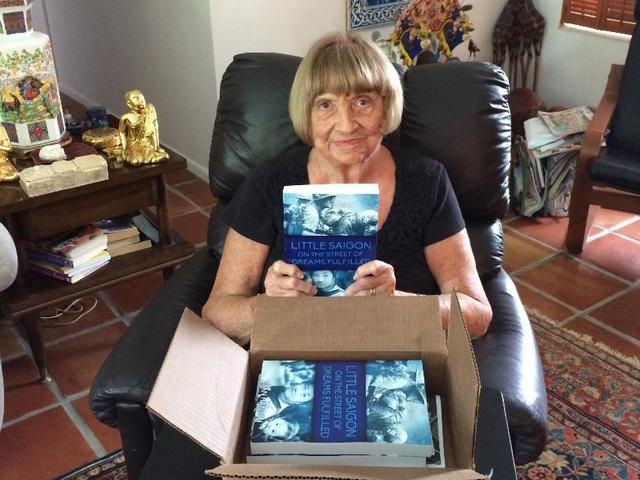 Joan Rindfuss Hansen is pictured with copies of her new book.