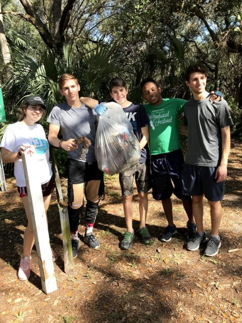 Palmer Trinity School's Eco Club helps clean Kendall Indian Hammocks Park