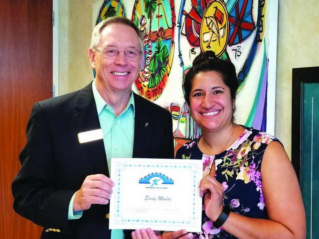 "Express Employment Pros presents ""Bridge to a Job"" certificate to Emily Munoz"