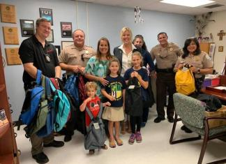 Ocaquatics Swim School joins village to distribute backpacks