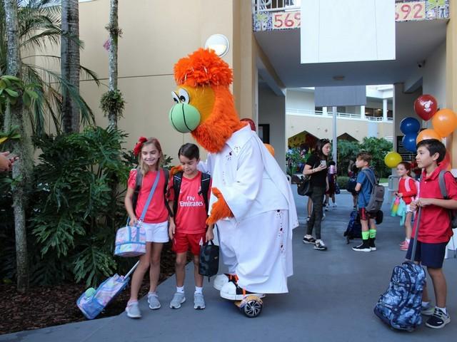 Miami Heat's 'Burnie' visits students at St. Thomas Episcopal Parish School