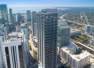 CMC Group pays off $236M in building loans for Miami's Brickell Flatiron tower