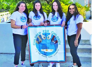 Local students form club to help children in need