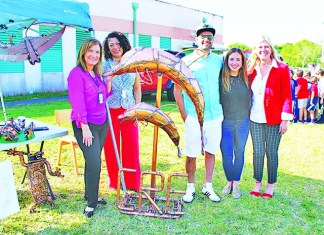 Village artist donates dolphin sculpture to Coral Reef Elem