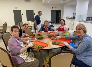 Volunteers prepare grape leaves and more for upcoming Lebanese Festival.