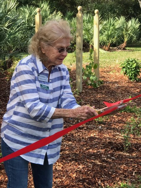 East Ridge resident Nancy Fehr cuts the ceremonial ribbon.
