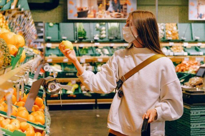 woman-in-white-long-sleeve-shirt-holding-lemon-fruit-3962290.jpg