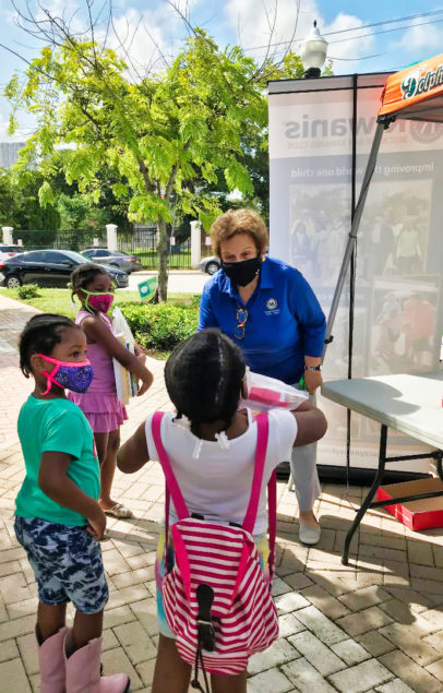 Rep. Shalala, police join Biscayne Bay Kiwanis in school supply giveaway