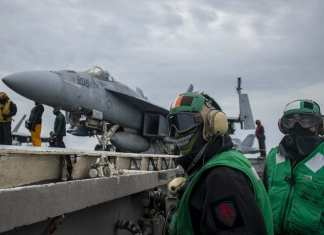 Miami Sailor prepares to launch aircraft aboard U.S. Navy carrier
