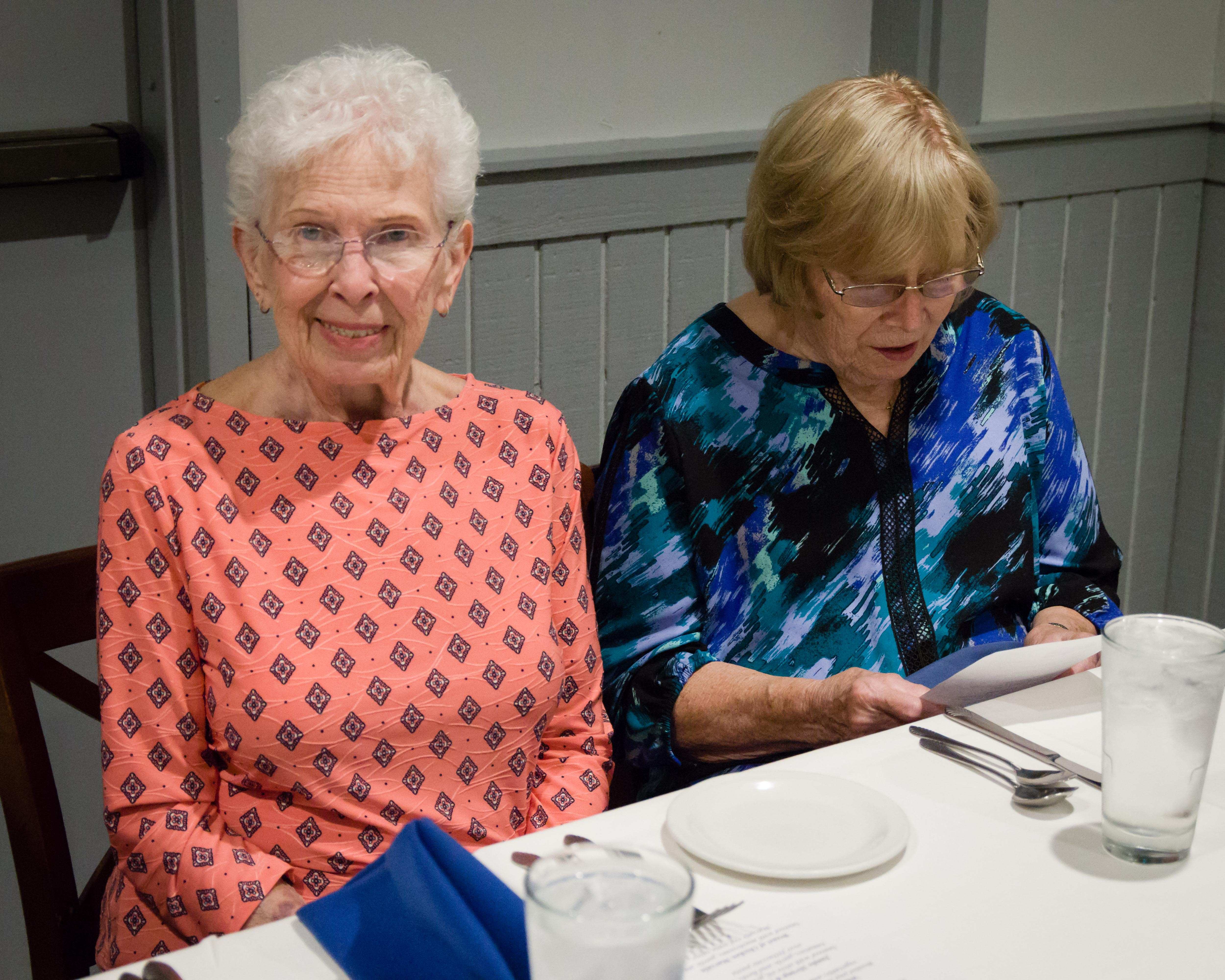 A smile from Arlene while Carol reviews the menu