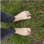 Bare feet walking on grass