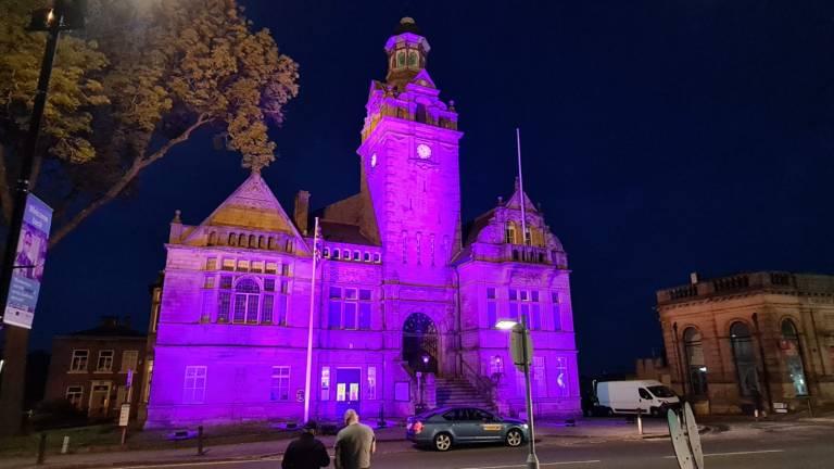 Cleckheaton Town Hall lit up purple