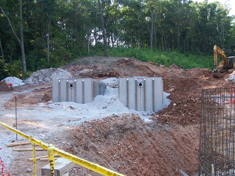 tandem wastewater treatment tanks being installed