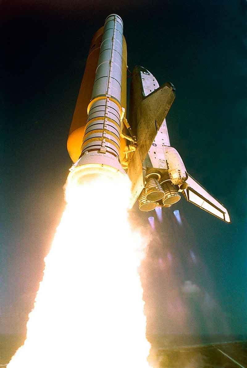 Space shuttle Atlantis taking off.  Booster rockets!