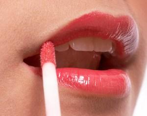 Girl Making Herself Up Applying Lip Gloss