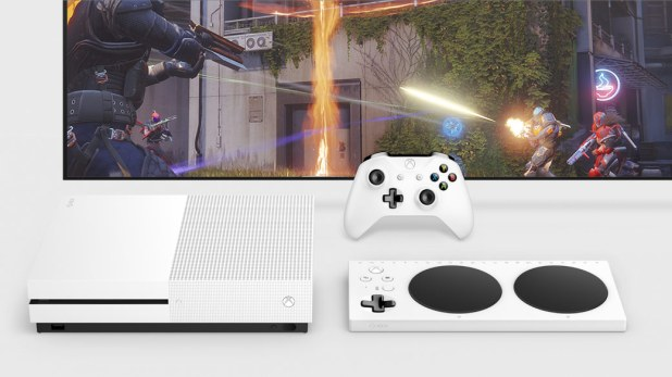 Top down view of the Xbox One S and Xbox Adaptive Controller on the front of a TV and white Xbox Controller