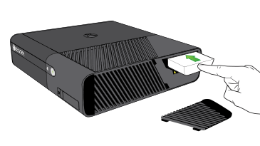 An illustration of a hand inserting a hard drive into the hard drive slot on an Xbox 360 E console