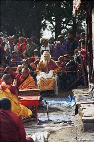 Mi-Tsering looks on