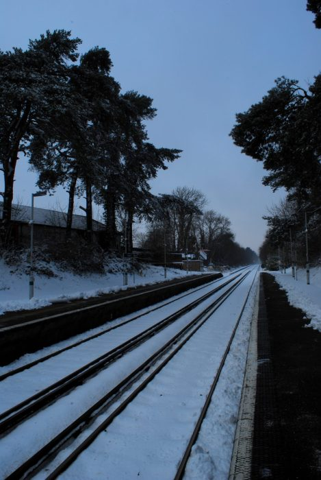 Snowy train tracks in London