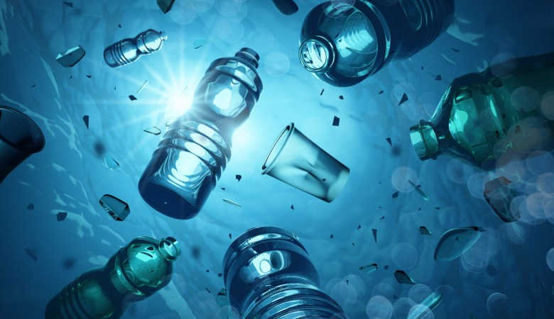 Problem plastic bottles and microplastics floating in the open ocean. Marine plastic pollution concept. 3D illustration