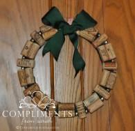 wine cork wreath with green ribbon