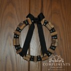 black wine cork wreath with jingle bells