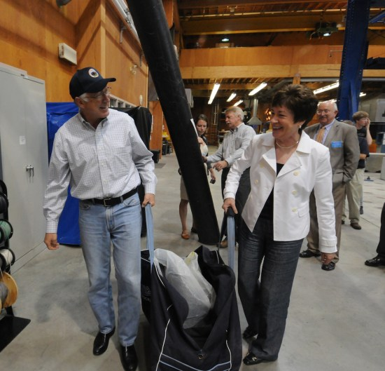 "Senator Susan M. Collins and U.S. Secretary of the Interior Ken Salazar with a ""Bridge-in-a-Backpack,"" during Salazar's 2011 visit to the Offshore Wind Laboratory."