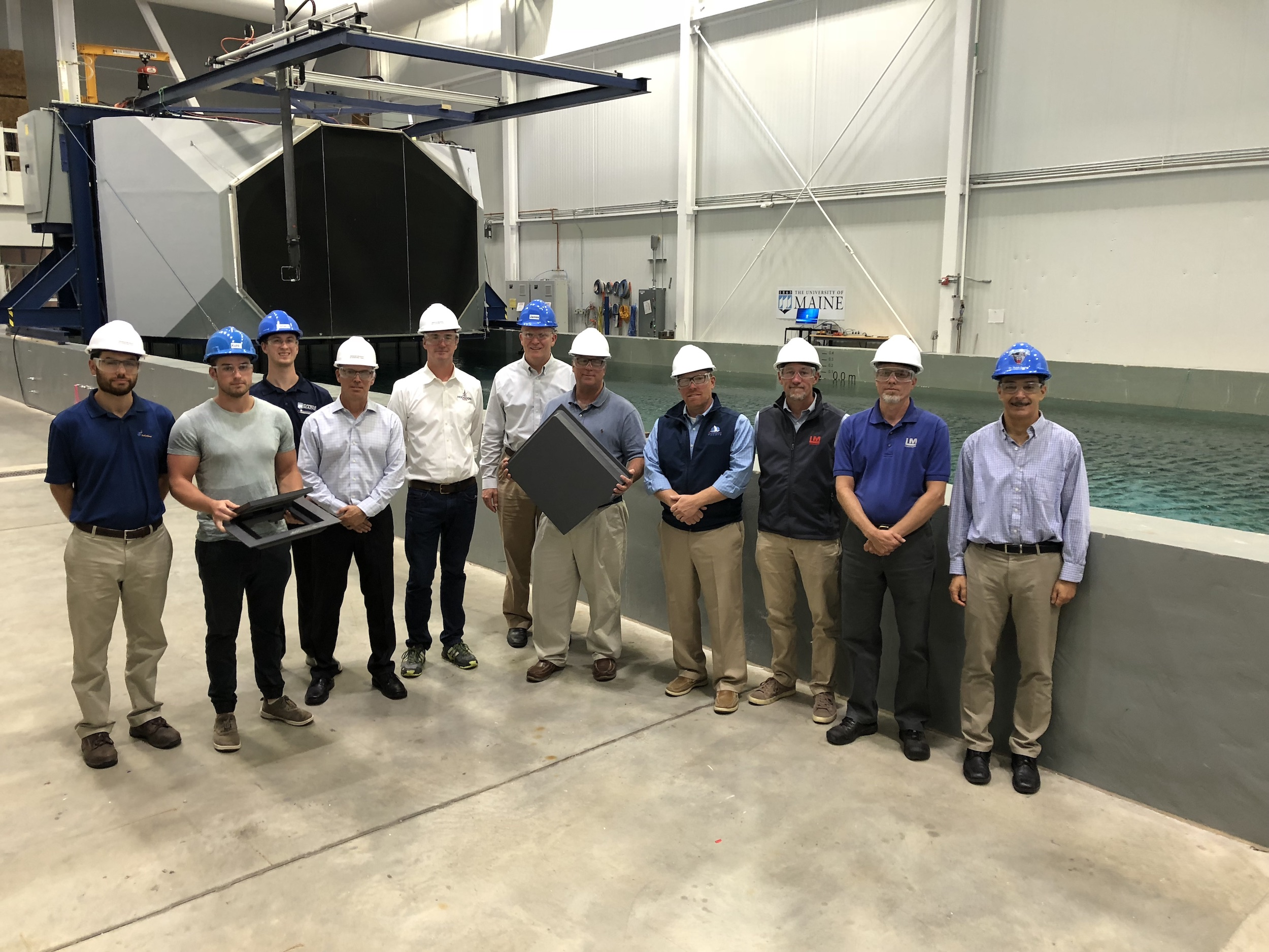 Maine boatbuilders pose for a photo at the Advanced Structures and Composites Center