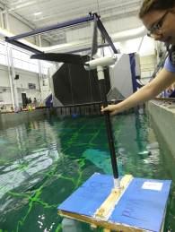 Photo of a student testing a floating wind turbine platform