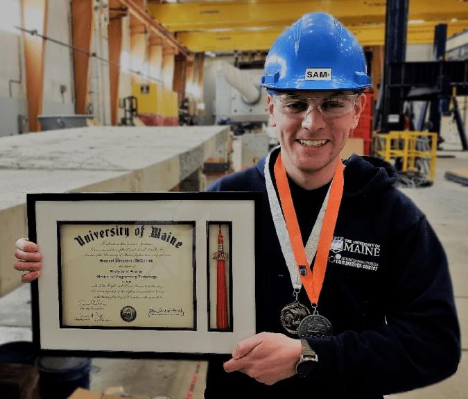 Samuel McDonald posing with diploma