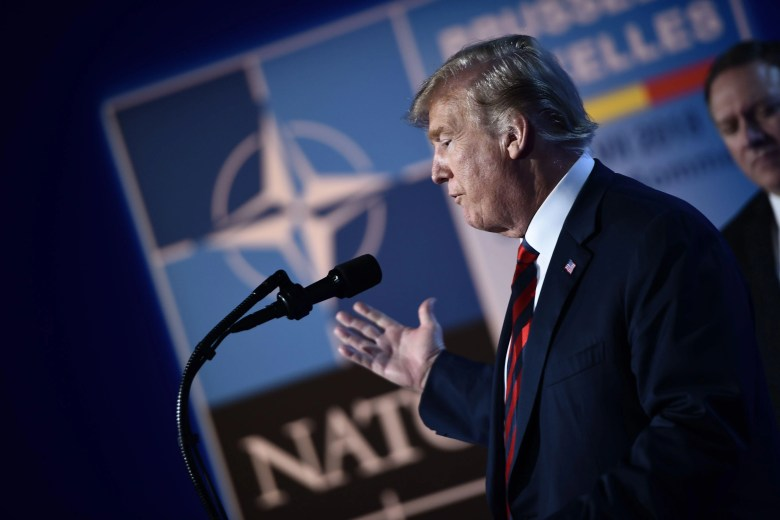 President Donald Trump gestures as he addresses a press conference at the NATO summit in Brussels on Thursday.