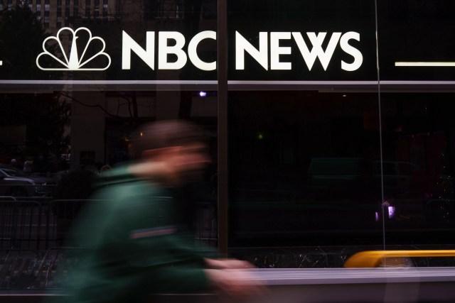 A pedestrian walks past the NBC News studios, Nov. 29, 2017 in New York City.