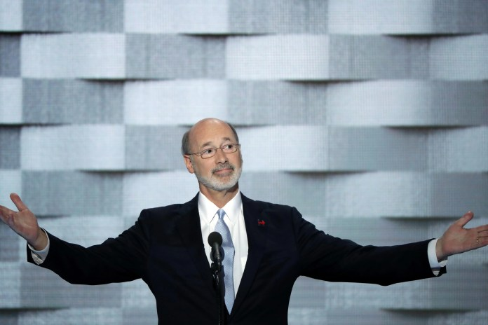 Pennsylvania Gov. Tom Wolf holds out his hands while at the podium for the Democratic National Convention.