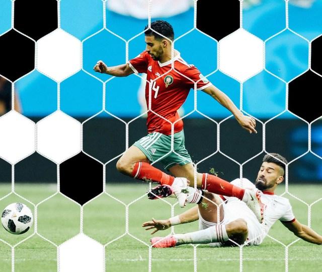 Grass Flies As Manuel Da Costa Of Morocco Is Fouled By Ramin Rezaeian Of Iran