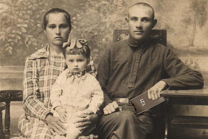 A 19th-century family. Mom is holding a child. Dad is holding an iPhone.