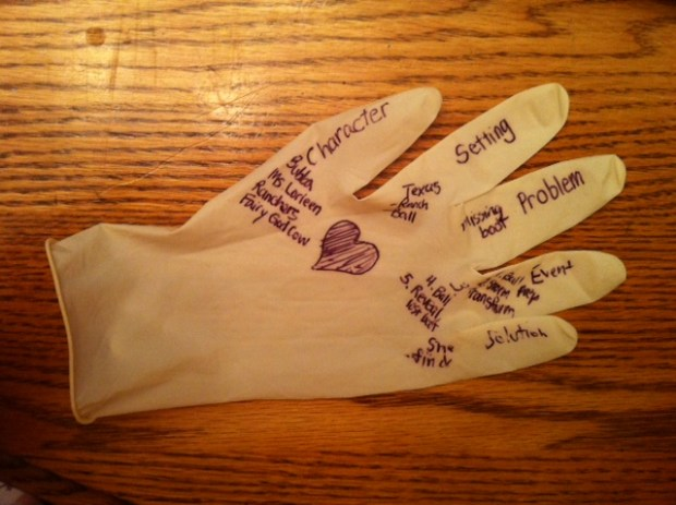 Story elements glove - students identify the story elements from a class story and write them in pen on a latex glove that they are wearing.