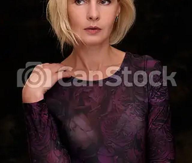 Beautiful Mature Woman Portrait On Black Csp50141787