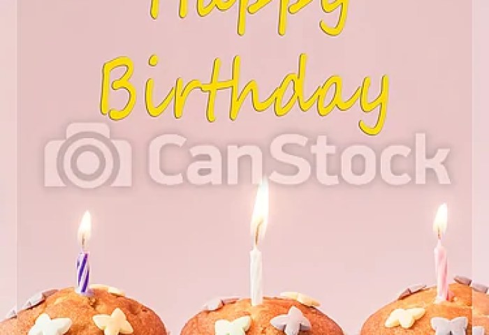 Birthday Cupcakes With Candles On The Table Pink Background The
